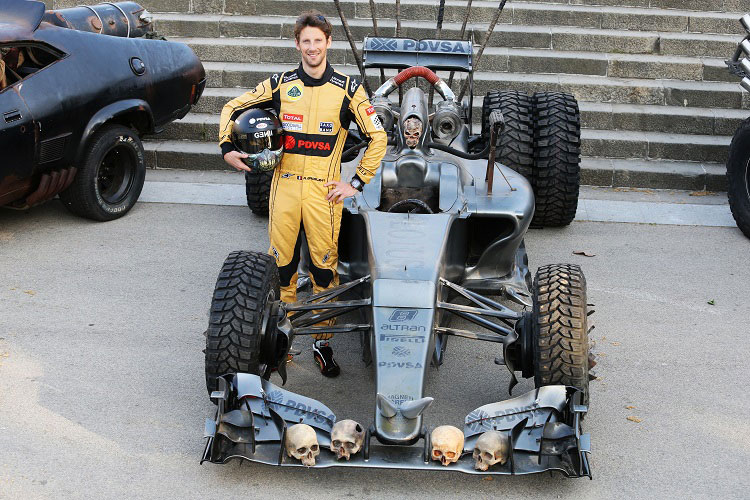 Driver Romain Grosjean poses with the Mad Max Fury Road Lotus F1 Concept